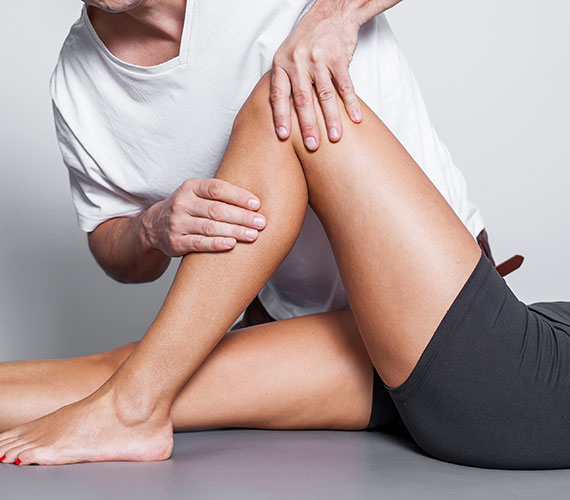 Physiotherapy leg massage in spa salon.
